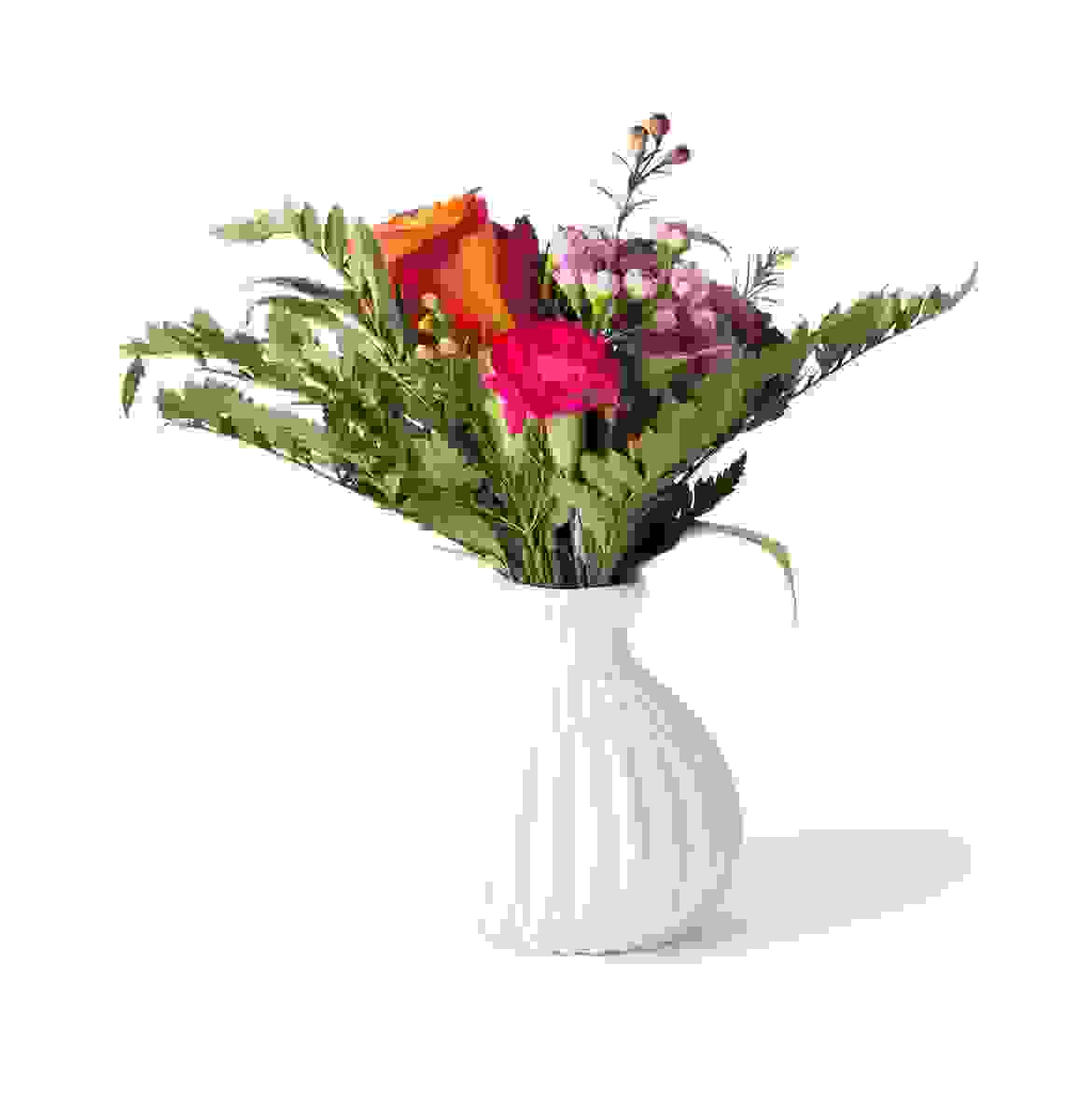 White flower vase with cherry red flower
